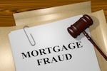 Mortgage fraud in print with a gavel