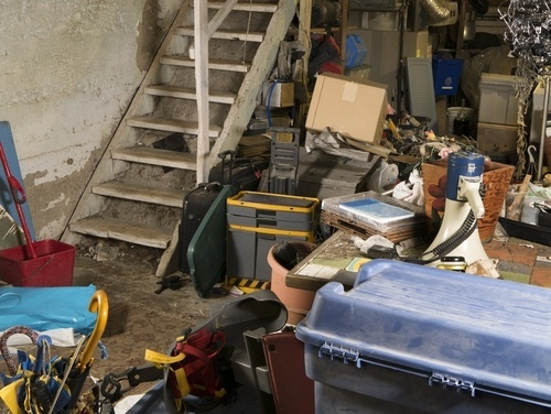 Cluttered basement filled with messy, scattered belongings