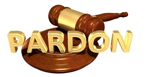 "Word ""pardon"" superimposed over judge's gavel"