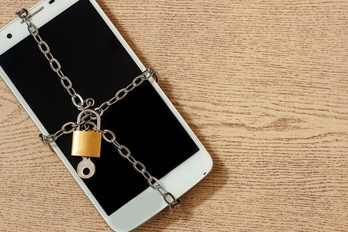 Cell phone secured by chain, lock and key