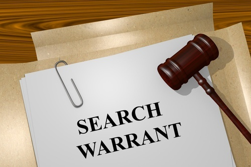 Search warrant document and the judge's gavel