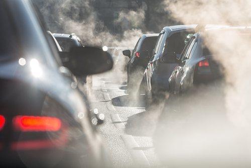 Columns of cars emitting smog