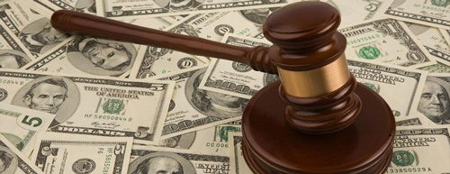 judge's gavel placed on top of cash