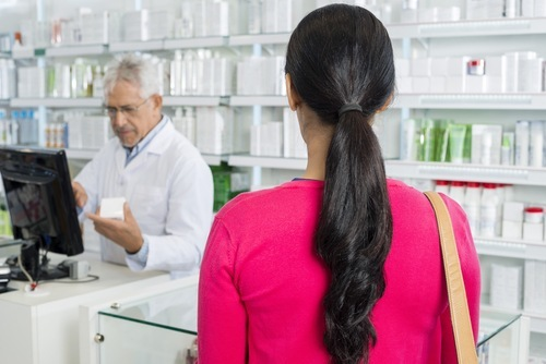Brunette woman at the pharmacy counter