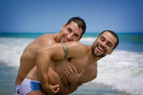 Two young men embracing