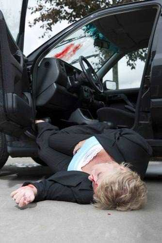 female auto accident victim bloody