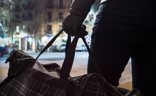 terrorist holding a bag