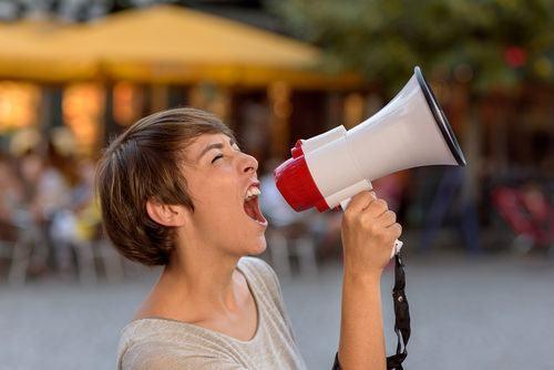 girl shouting into bullhorn