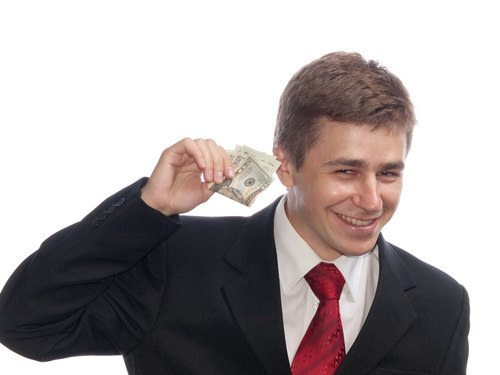 smiling man with money in hand