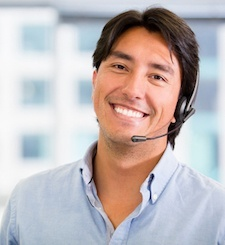 Male receptionist smiling