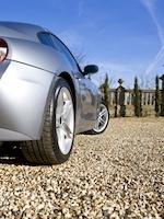 Car on gravel driveway