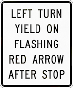 "Traffic sign that says, ""Left turn yield on flashing red arrow after stop"""