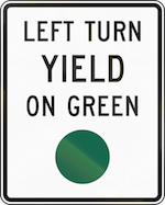 "Traffic sign that says, ""Left Turn Yield on Green"""
