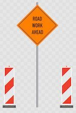 "Traffic cones and ""Road Work Ahead"" sign"