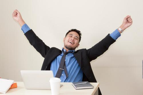 Man happy, raising hands in the air