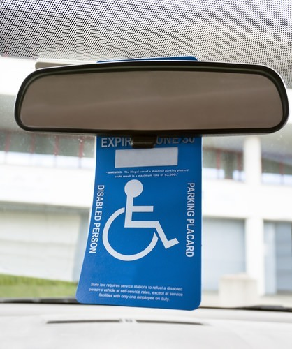 disability placard hanging from rear view mirror