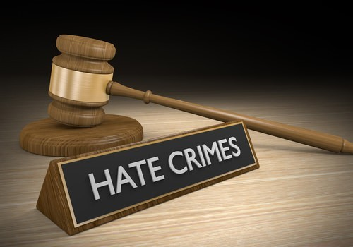 sign that says hate crimes, and a gavel.