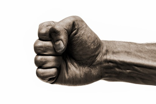 man's fist clenched