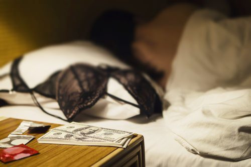 cash on bedstand, bra on bed (prostitution)