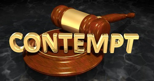"""""""contempt"""" spelled out over a judge's gavel"""