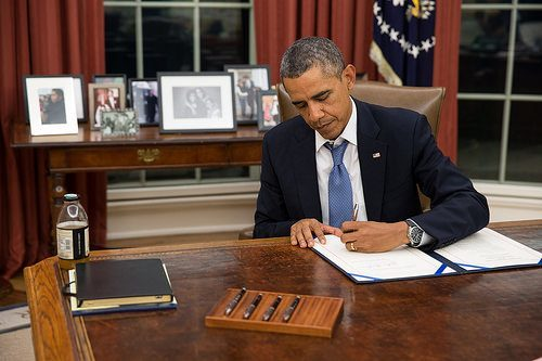 President Obama signing a bill