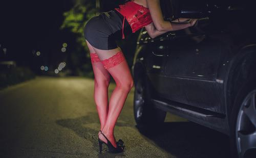 prostitute hanging out by car