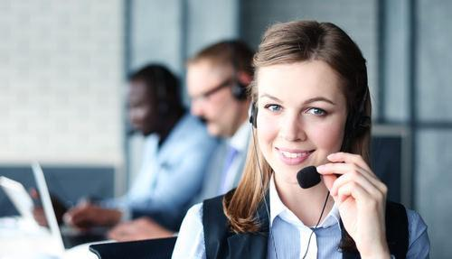female receptionist with headset smiling