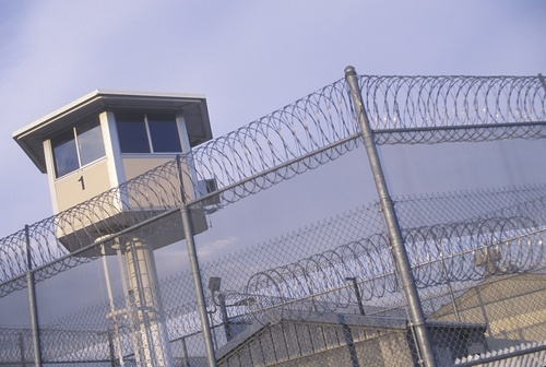 Watchtower and barbed wire fence at California prison