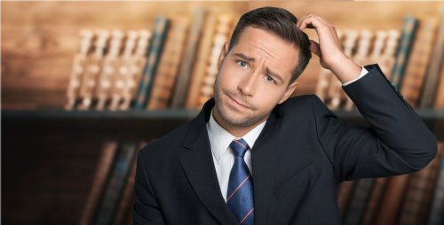 confused attorney scratching his head