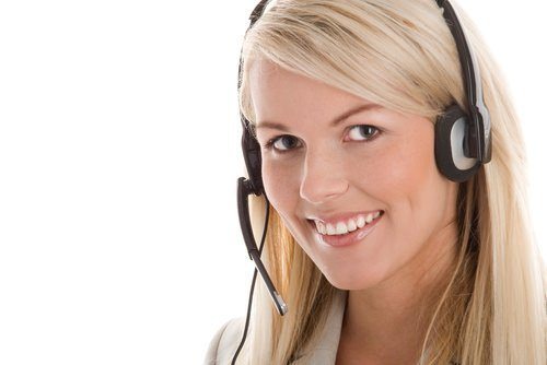 female receptionist smiling with headset