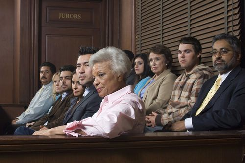 a diverse jury sitting in a jury box