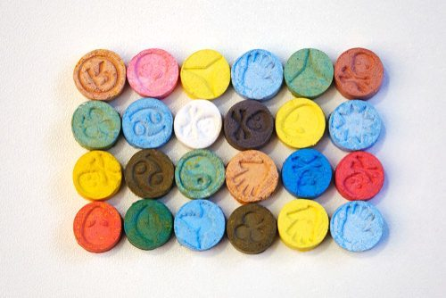 rainbow assortment of colorful ecstasy pills