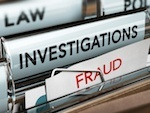 File folders entitled law, investigation, and fraud