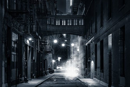 a dark urban scene with smoke in the air