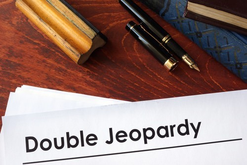 "a paper with ""double jeopardy"" printed out on top"
