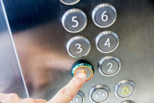 pushing button in elevator - elevator accidents may result in settlements for the injured party