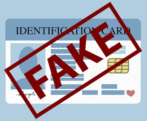 "Cartoon rendering of ID card with the word ""Fake"" stamped on it"