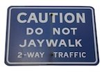 Traffic sign cautioning against jaywalking