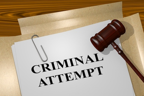 """Paper with words """"criminal attempt"""" and a gavel by it"""