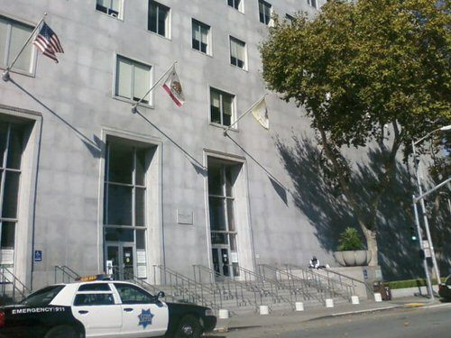 exterior of cement building with police car parked outside