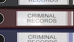 "Spine of binders that say ""criminal records"""