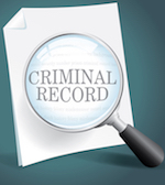 Magnifying glass over paper with the text criminal record.
