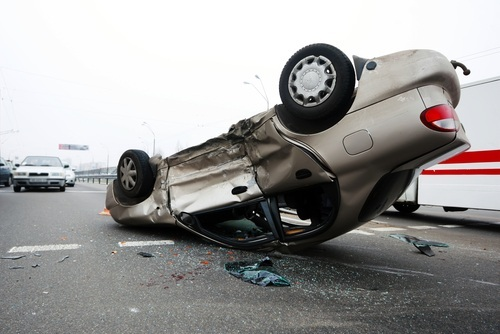overturned car with bad damage; causing an accident while intoxicated can be charged as DUI murder