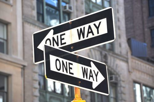 one way signs pointing in different directions