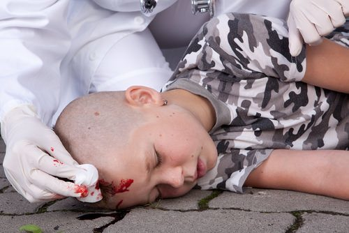 boy passed out with injury to his head