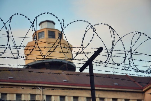 prison surrounded by barbed wire