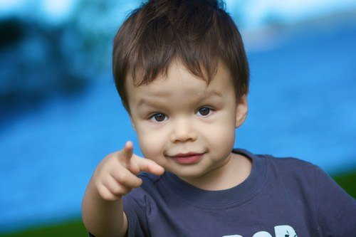 young boy pointing his finger