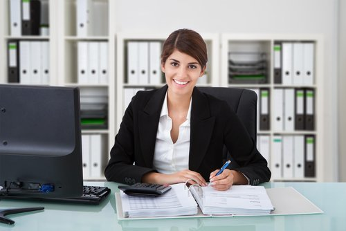 smiling female accountant at a desk