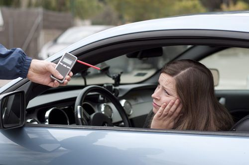 girl looks sad after breathalyzer test BAC DUI california attorneys can help