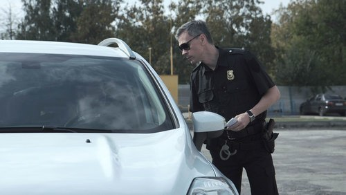 police next to car during marijuana dui inquiry